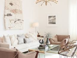 glass coffee table wall art tall ceiling white beams plants black
