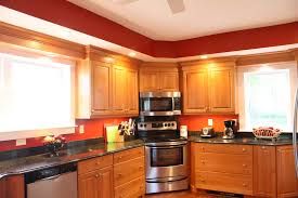 cherry wood cabinet kitchen stainless steel appliances corner