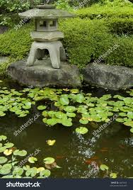 traditional japanese garden stone lantern small stock photo