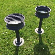 Backyard Classic Professional Charcoal Grill by A Charcoal Grill And A Beer Cooler Ice Bucket Made Out Of Old