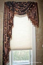 asymmetrical swag and cascade valance with beaded trim window