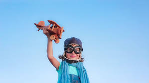 happy child with airplane against summer sky