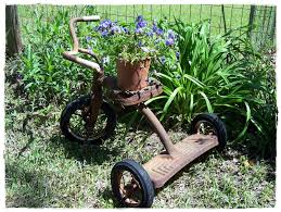 rusty old tricycle garden art i have this tricycle in my basement