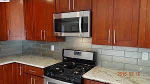 interior design mosaic tile backsplash with white kraftmaid