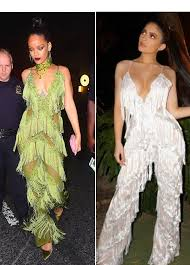 rihanna jumpsuit jenner channels rihanna flaunts cleavage in same exact