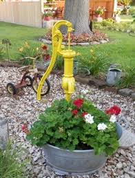 displaying antique pumps in your garden flea market gardening