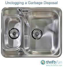 kitchen sink drain motor unclogging a garbage disposal thriftyfun
