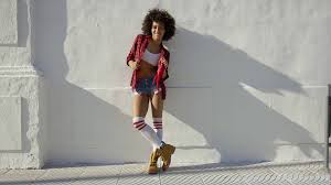 white concrete wall beautiful fashionable african american leaning against white
