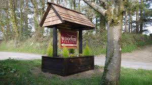 wishing well planter sign the wooden workshop oakford devon