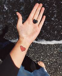 tetu in hand heart tattoo ideas popsugar love u0026