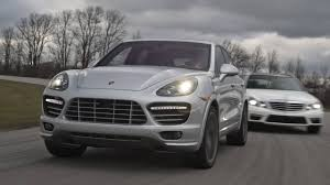 porsche suv blacked out comparison porsche cayenne turbo vs mercedes benz e63 amg wagon