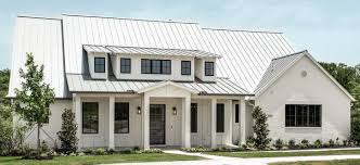 modern farm house la cantera metal roof white painted brick