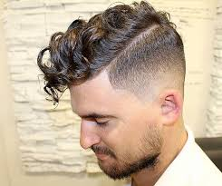 where can a guy get a good top knot style haircut 11 cool curly hairstyles for men