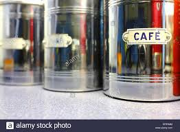 kitchen metal containers with different labels stock photo