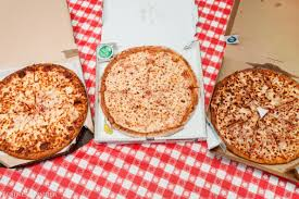 we taste tested pizzas from papa s pizza hut and domino s