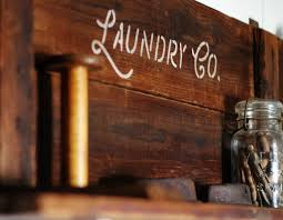 laundry room sign stenciled on salvaged wood shelf knick of time