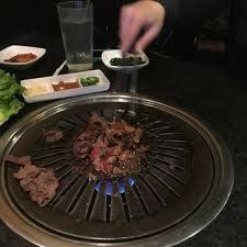 japanese restaurant cook at table image result for japanese grill table to cook meats at restaurant
