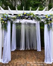 wedding florist near me pergola decorated with fabric and floral arrangements for a