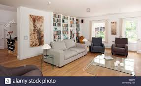 Large Artwork For Living Room Modern Living Room With Neutral Sofas And Large Wall Book Case And