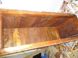 making a wooden blanket box out of pallets and adding some stain
