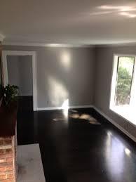 gray walls with dark hardwood floors home loversiq
