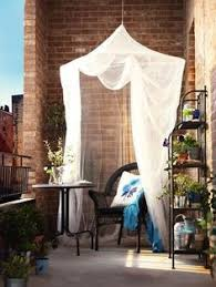 for extra balcony privacy try hanging a simple curtain and
