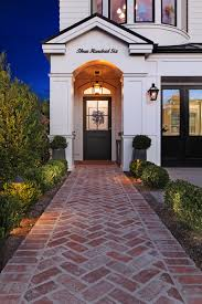 Home Interiors By Design by A Brick Pathway Leads You To The Front Door Patterson Custom
