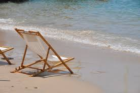 Beach Lounge Chair Brown Wooden Beach Lounge Chair On Sea Shore During Daytime Free