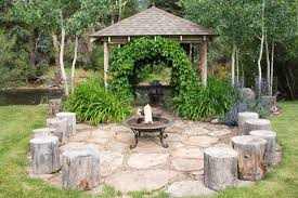 fire pit with seating stone fire pit with log seating and riverfront arbor picture of