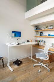 Raised Desk Shelf Float Humanscale U0027s Height Adjustable Sit Stand Table
