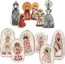balsa wood ornaments above embroidered and beaded ornaments below