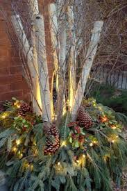 Christmas Decorations For Outdoor Containers by 24 Colorful Outdoor Planters For Winter And Christmas Decorations