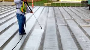 Surecoat Roof Coating by Power Washing To Prep For Uniflex Elastomeric Roof Coating Install