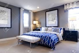 modern master bedroom with blue wall and white linens stock photo modern master bedroom with blue wall and white linens stock photo 15079414