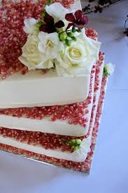 red velvet wedding cake decorated with pomegranate and whi u2026 flickr