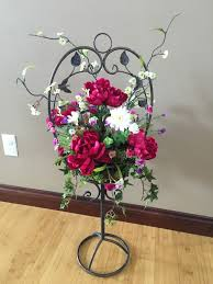 wrought iron stand with floral arrangement home decor silk