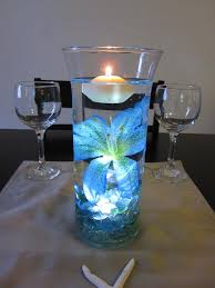 submersible led tea lights glowing floral centerpiece use our blue submersible tea lights