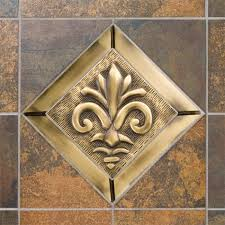 4 solid brass wall tile with fleur de lis design kitchen