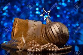 christmas decorations in gold tones defocused blue light in