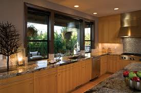 modern kitchen window a sleek contemporary kitchen with granite tops and large slim
