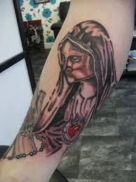religious sinkingin tattoos