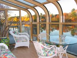 decorating small sunroom furniture walnut chairs beige deep seat