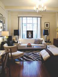 small apartement decoration with gray velvet sofa combined with