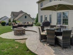 Backyard Concrete Patio Ideas by Traditional Stamped Concrete Patio Ideas With Traditional Round