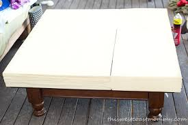 how to turn your old coffee table into a stylish ottoman this
