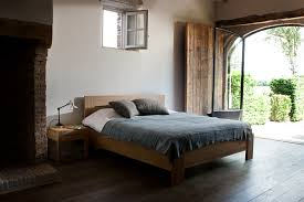 oak azure bed and bedside table by ethnicraft bedroom
