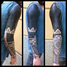 cool blackwork tattoo sleeve with elbow mandala best tattoo