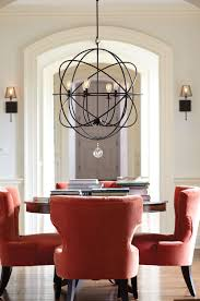 black color metal oversized chandeliers above round wooden table black color metal oversized chandeliers above round wooden table and red chair ideas