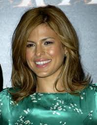 medium length flipped up hairstyles eva mendes wearing her shoulder length hair with tilting up on the