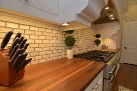 countertops white subway tile white cabinets butcher block